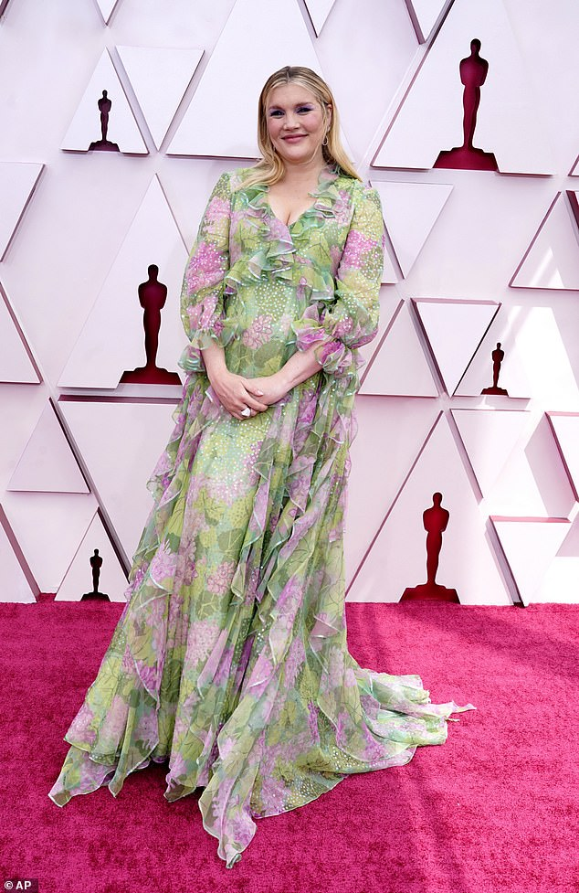 Glowing:The actress, 35, looked radiant in a green and pink billowing Gucci gown as she attended the socially-distanced Oscars ceremony amid her Best Director nomination for Promising Young Woman