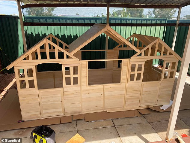 To make the street of shops, Kymberleigh first of all bought two cubby houses at $199 each from Kmart (pictured) - and she then attached them together with extra wood