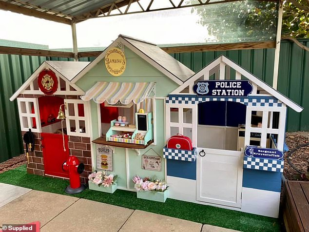 A devoted mother has made her son a miniature street of shops from the popular Kmart cubby houses, and she spent less than $800 on the whole project (the street of shops pictured)