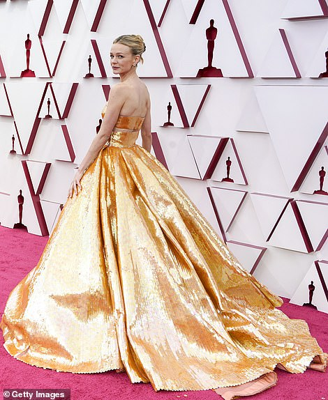 The British beauty wore her blonde hair pulled back into an elegant updo