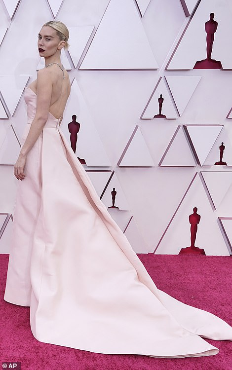 complete with a cut-out detail along her midsection and a v-neckline