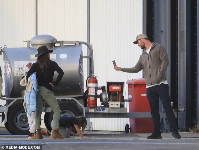 Making memories! Hollywood star Chris Hemsworth snapped pictures of his wife Elsa Pataky and their children after they flew into Sydney via private helicopter on Monday