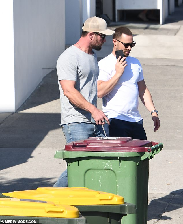 Sneaking out: The superstar made a low-key exit via a back door at the restaurant, with Aaron chatting on his phone as they made their way out onto the street