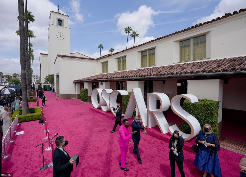 Amazing: The Oscars went all out with a stunning vibrant pink carpet and a statue outside the venue