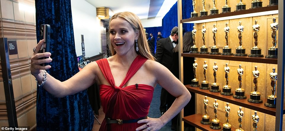 Snap decision: Reese Witherspoon posed for a series of candid selfies backstage at the Academy Awards, held at Downtown Los Angeles' Union Station on Sunday evening