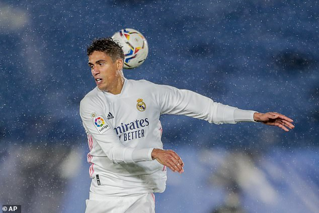 Real Madrid defender Raphael Varane says he remains '100 per cent committed' to the club