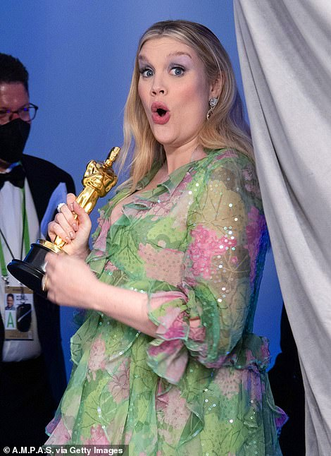 Statuette: Meanwhile, Emerald Fennell clutched her statuette