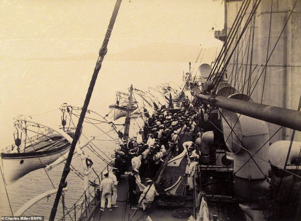 Fascinating previously unseen photographs taken by a British naval officer who travelled the world 120 years ago have come to light. Henry Taprell Dorling served on Royal Navy cruiser HMS Terrible in the Second Boer War in South Africa before heading on to the Far East. Pictured: One image seen in Dorlin's album shows the crew of HMS Terrible on board the ship