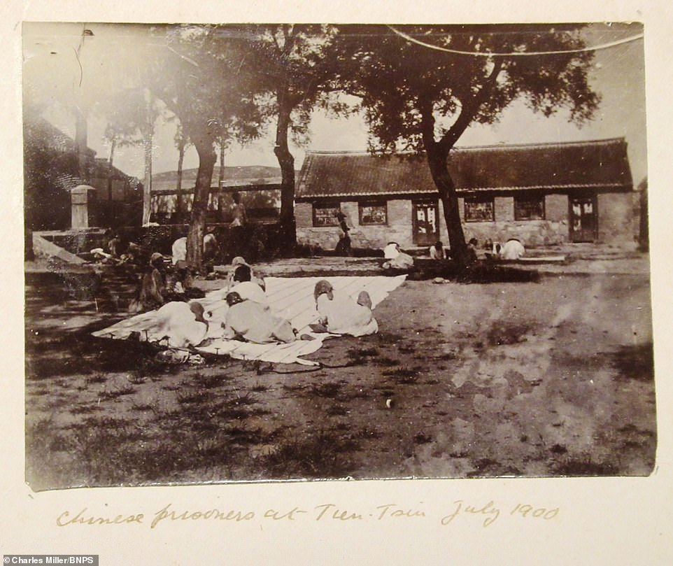 Dorling, who served in the navy from 1897 to 1929 and came out of retirement during World War Two, also took photos of the stunning scenery including an old Chinese fort. Pictured: Chinese people enjoy laying on a blanket in a garden in July 190