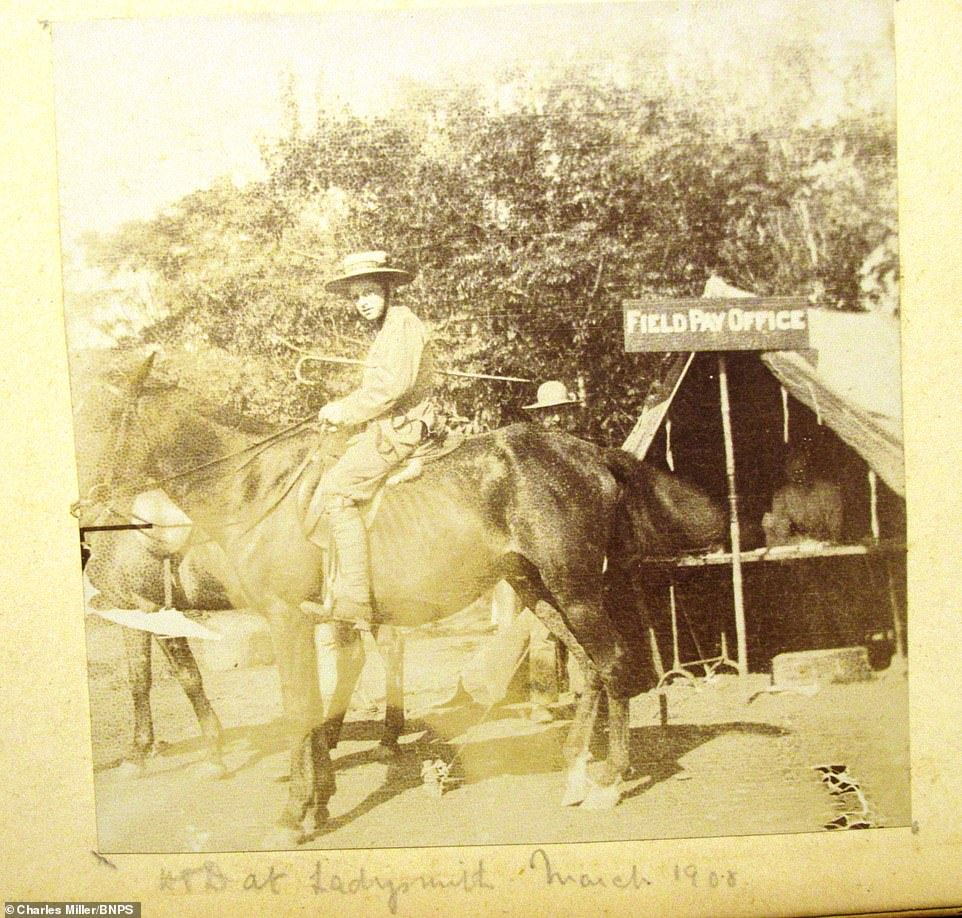 As the British Army was besieged by Boer fighters in the garrison town of Ladysmith, Natal, the Royal Navy landed guns from HMS Terrible and her sister ship HMS Powerful to help in the relief of the siege. Pictured:A man riding a horse is seen in March 1908 outside a Field Pay Office in Ladysmith, South Africa