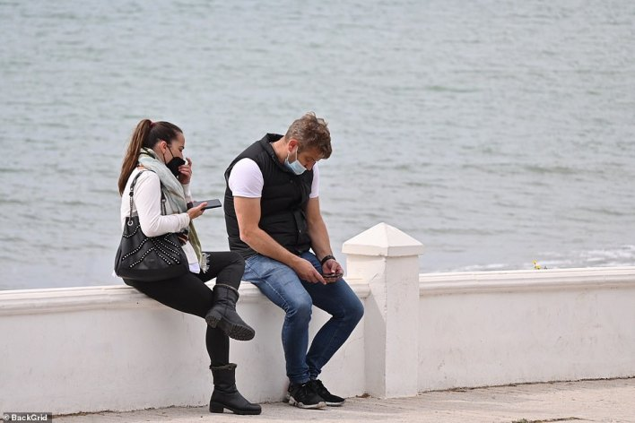 Elliot sits on the seafront after visiting hisCosta del Sol restaurant Olivia's La Cala which has been gutted by fire
