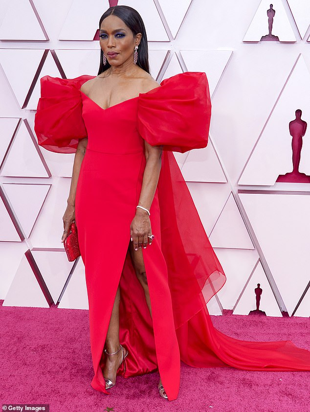 Speech:Angela Bassett remembered those who have lost their lives to Covid and 'violence of inequality, hatred and racism' during the Oscar's In Memoriam segment on Sunday