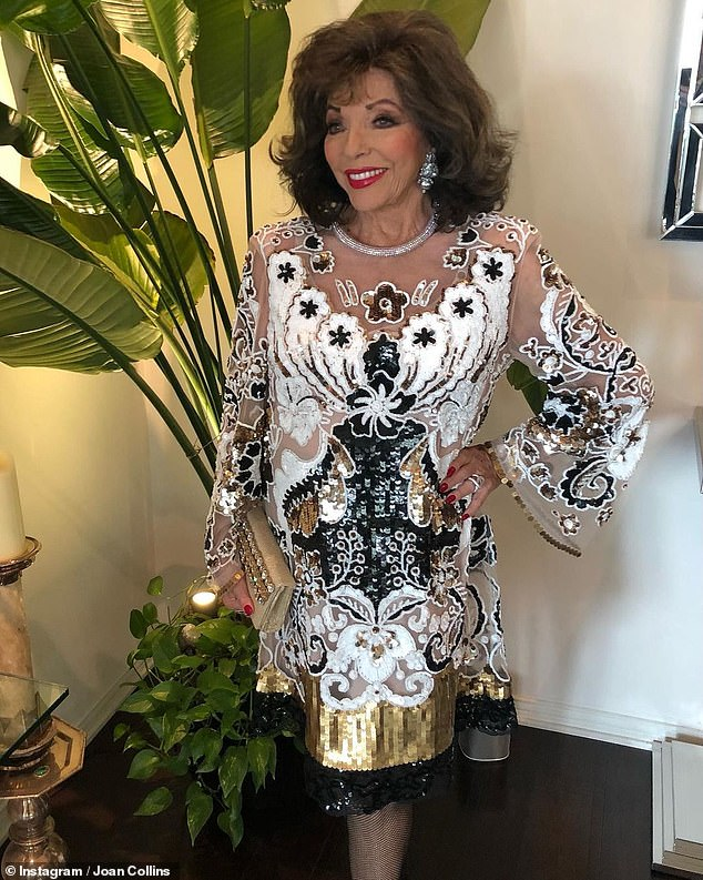 Work it!  Joan exuded Hollywood glamor by wearing a dress from Maison Valentino covered in sequins while enjoying the Oscars last month.