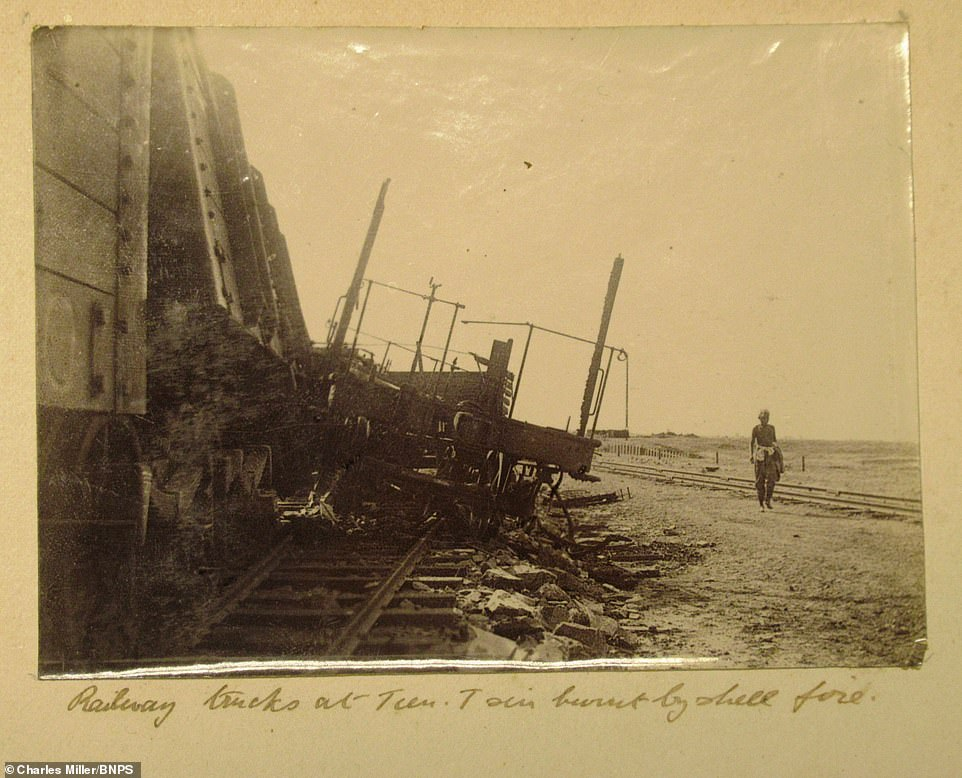 During his time in South Africa, Dorling also took this image of a derailed train, which he said had been knocked off course by the force of a shell