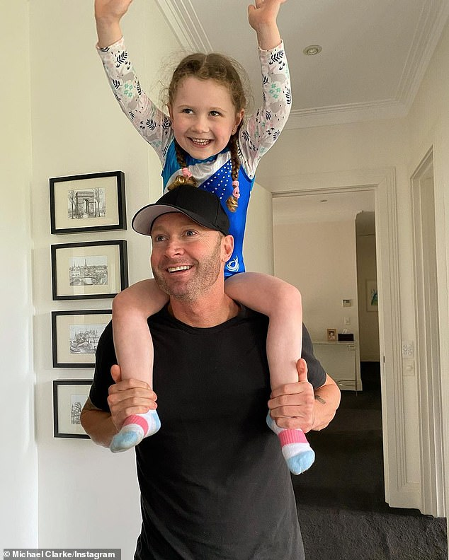 Daddy daughter day:Michael Clarke (front) was a picture of a doting dad on Monday. The former cricketer, 40, enjoyed playtime with his daughter, Kelsey Lee, five, (back) sharing some images of the sweet moments on Instagram Stories