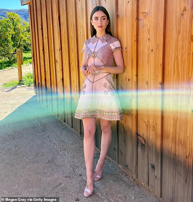 Stunning: It comes after Lily put on a very glamorous display in a pink bejewelled dress ahead of the virtual 27th annual SAG Awards