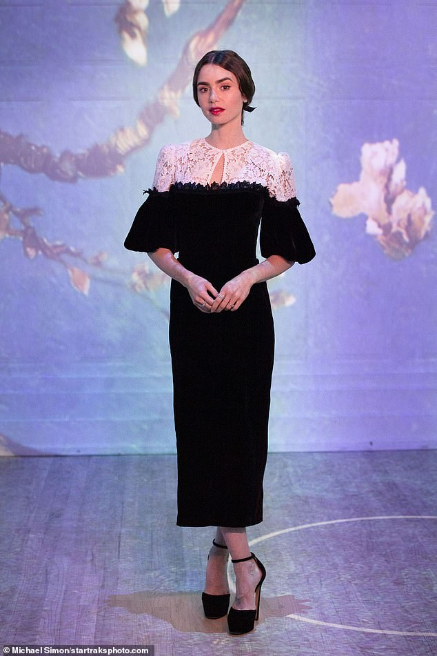 Stunning:Lily Collins, 32, made a stylish stop in Chicago, where she took in the acclaimed Immersive Van Gogh Exhibit wearing a black and white lace dress