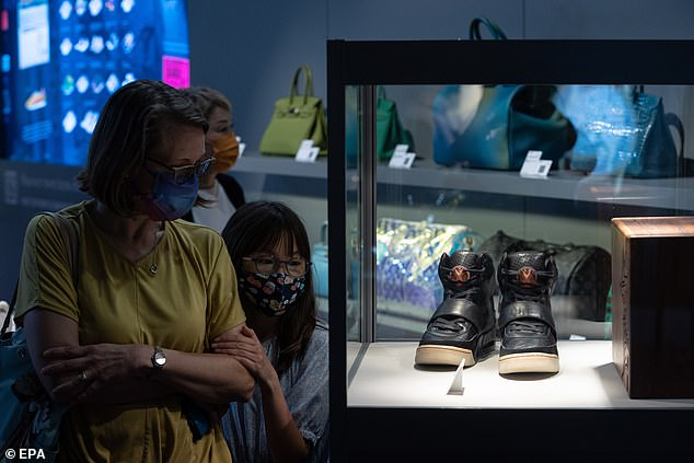 The Yeezy sneaker prototype that West wore during the 2008 Grammy's are on display before the Sotheby's auction in Hong Kong.