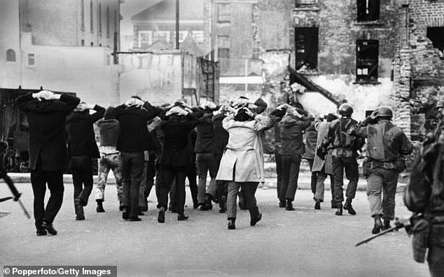 IRA terrorist suspects are rounded up by British soldiers on Bloody Sunday in Londonderry