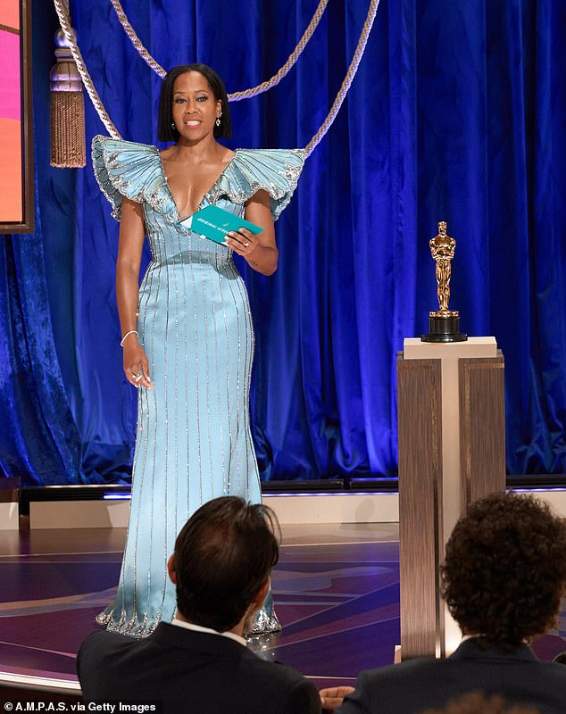 The number of people who tuned into watch the Oscars last night has hit an all time low with just 9.85 million viewers. Pictured above in Regina King presenting the Oscar for Original Screenplay