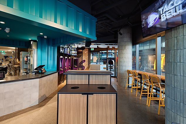 The restaurant features an open kitchen (left) so customers can see their orders being freshly prepared to order