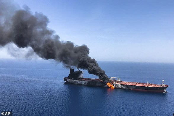 An oil tanker burns in the Strait of Hormuz - one of two belonging to Japan and Norway that were attacked on June 13