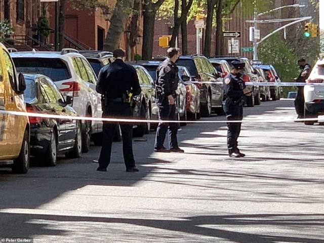 Police cordon off the scene of Monday's fatal shooting. Park Avenue is visible at the top of the hill. The leafy neighborhood is full of multimillion-dollar homes
