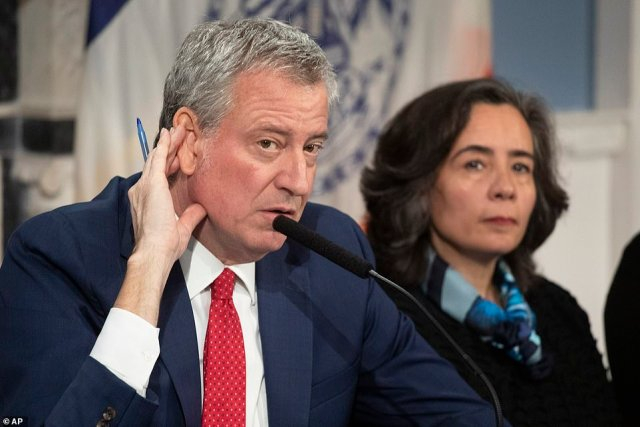 Bill de Blasio, the mayor of New York, is accused by critics of ignoring gun violence in the city