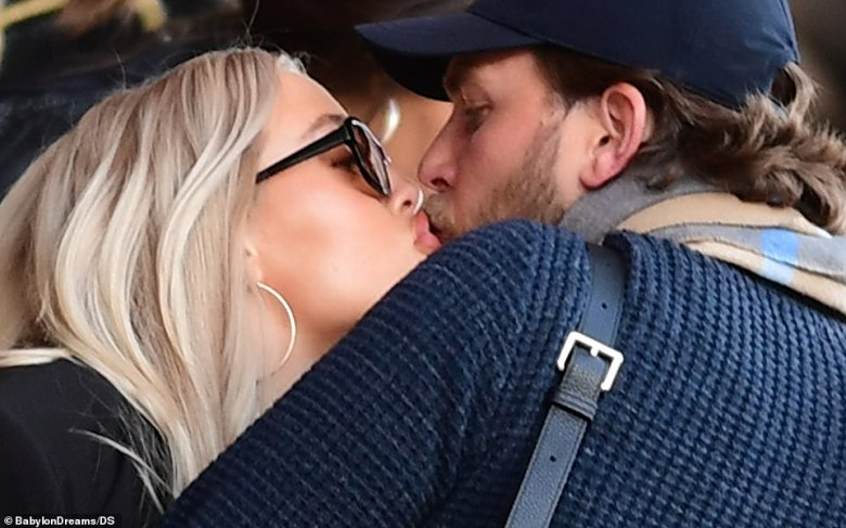 Centre of attention: Lottie and Lewis looked in love as they puckered up over their starters