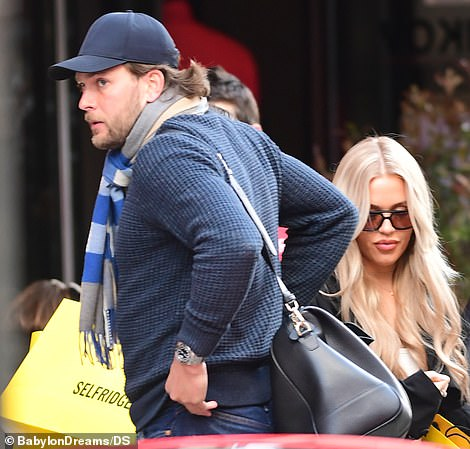 Couple time: Both Lottie and Lewis looked stylish for their lunch date