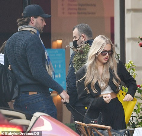 Got everything? Lottie was seen checking her shopping bag before heading off