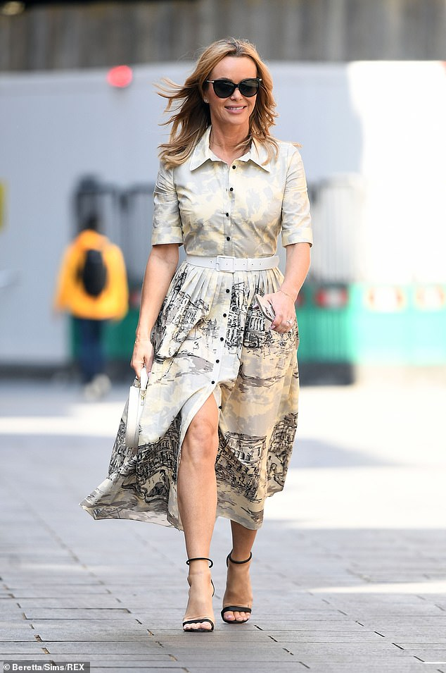 Style savvy:The presenter, 50, ensured all eyes were on her as she slipped into cream and grey shirt dress by Suzannah London