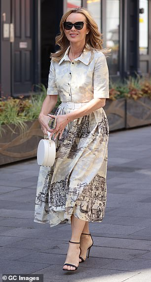 Commanding attention: The broadcaster's outfit was complemented with a white waistbelt and black strappy heels