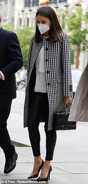 Looking typically stylish, Letizia teamed her £333 black and white coat, from Spanish brand Mirto, with an elegant white blouse