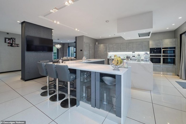 Neville and wife Julie - who were childhood sweethearts - completed a refurbishment last year, to bring the swish pad up to date (kitchen pictured)
