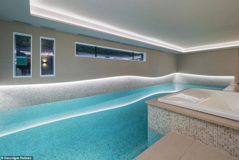 The six-bedroom pad in Hale is complete with an indoor swimming pool (pictured), gym, cinema, underground car park and steel-line panic room