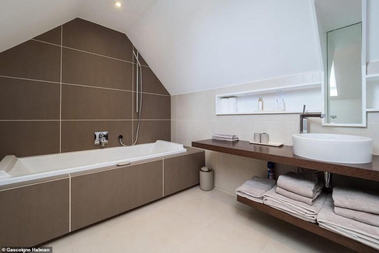 TheManchester United legend has already accepted an offer on his plush £5.25million Cheshire mansion which boasts six bathrooms (pictured)