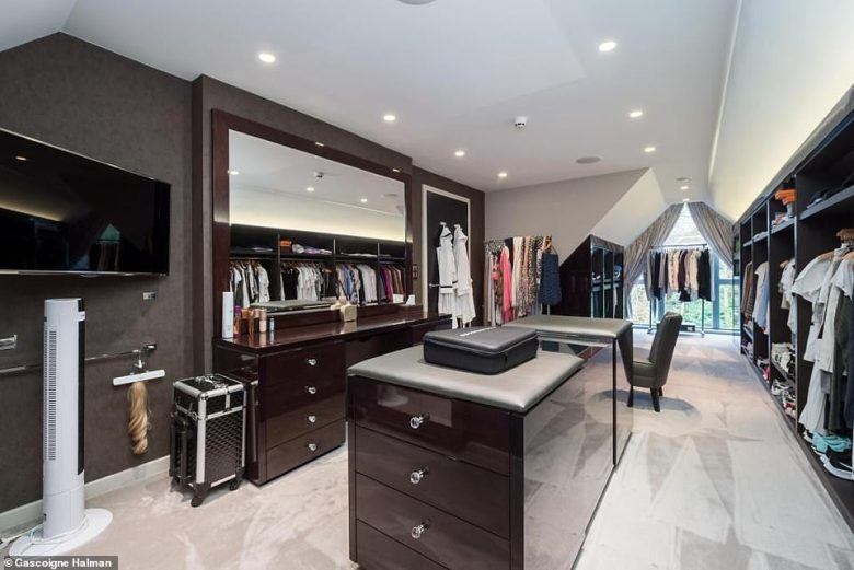 Estate agent Gascoigne Halman says the house 'is an individual, architecturally designed detached family home which is arranged over four floors and is the ultimate lifestyle statement' (dressing room pictured)