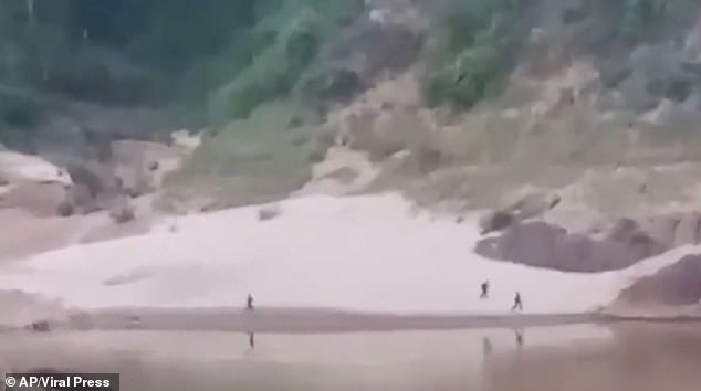 In a video shot from the Thai side of the border, people can be seen running across a riverbank.A report by the Karen Information Centre quoted an unnamed villager on the Thai side of the border saying he saw seven government soldiers trying to flee the camp