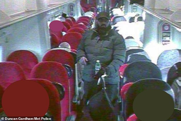 Khan pictured on a train to Euston. He got onto a more direct train that left at 7.44am but he did not have the right ticket and at 8.11am, when his ticket was checked onboard, he bought a discounted ticket