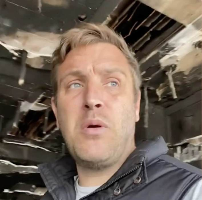 In a video uploaded online, the devastated 41-year-old walked around his restaurant, which has been completely destroyed by the fire, before pledging that he would have it reopened by summer