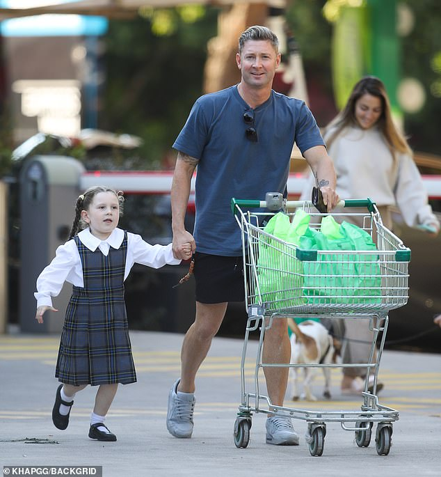 Daddy duties:Michael Clarke didn't seem to have a care in the world as he went grocery shopping with his five-year-old daughter Kelsey Lee in Sydney on Monday