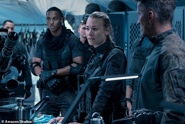 Joining the fight:Yvonne Strahovski plays a scientist in the movie