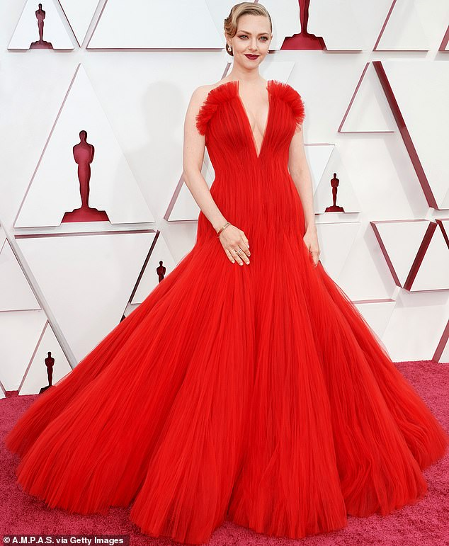 Looking fab:The Mean Girls actress dripped with chic in a cleavage-baring scarlet frock as she hit the red carpet at Union Station for the Oscars red carpet