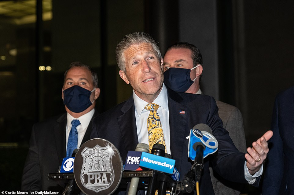 President of the Police Benevolent Association Patrick Lynch holds a press briefing outside of Queens Criminal court after her arraignment