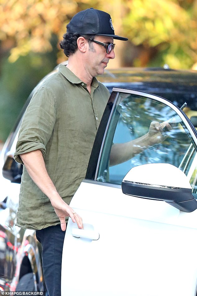 Casual:The actor stepped out wearing navy pants, a green buttoned shirt and a pair of white sneakers