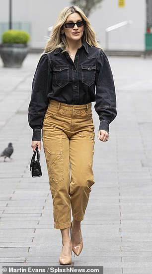Glam: Meanwhile Ashley opted for an edgy black denim shirt and camel culottes