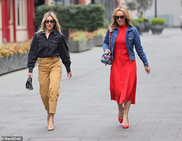 Dynamic duo: Amanda and Ashley made for a stylish duo as they strutted out of Global Studios in the heart of London's Leicester Square