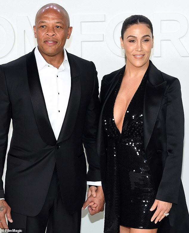 Hip-hop mogul Dr. Dre was ordered Tuesday to pay half a million dollars to his estranged wife Nicole's divorce lawyer, DailyMail.com can reveal