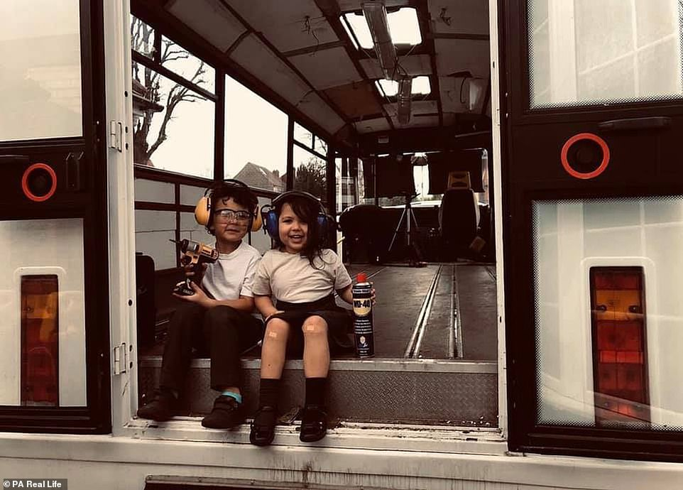 The couple moved out of their rented property and sold all of their belongings within six weeks of purchasing the former Bournemouth council bus. Pictured:Roman, eight, Arabella, six, helping with the bus revamp